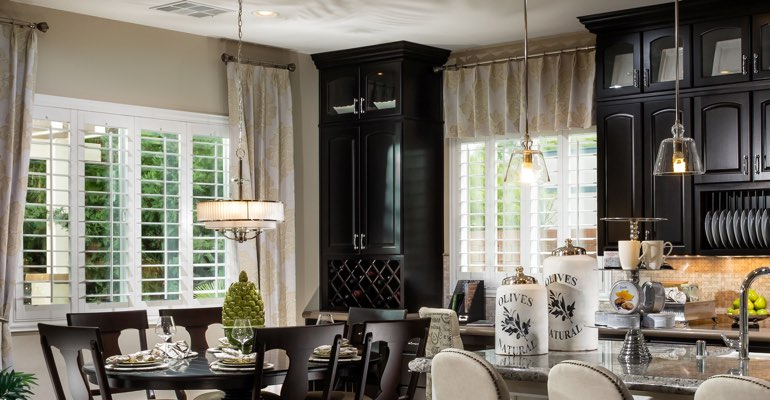 Southern California kitchen dining room with plantation shutters.